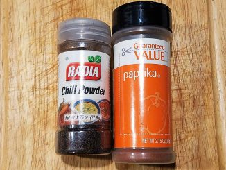 spice containers with Mexican chili powder and paprika